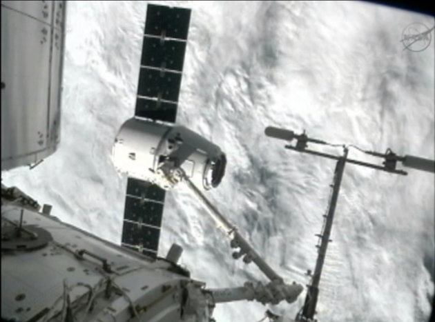 This image from NASA-TV shows the capture of the Dragon capsule by a robot arm on the International Space Station as they passed over the South Atlantic Ocean early Wednesday Oct. 10, 2012. It&#39;s the first official delivery by the California-based SpaceX company under a $1.6 billion contract with NASA. The contract calls for 12 such shipments. (AP Photo/NASA)
