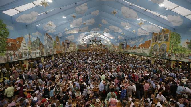"Visitors enjoy the opening day of the famous Bavarian ""Oktoberfest"" beer festival in the 'Hacker Pschorr'  beer tent in Munich, southern Germany, Saturday, Sept. 22, 2012. The world's largest beer festival, is  held from Sept. 22 to Oct. 7, 2012 and will see some million visitors. (AP Photo/Matthias Schrader)"