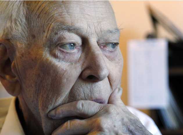 In this April 12, 2012 photo, an 88-year-old retired Coast Guard officer, who declined to be identified for fear of being targeted for fraud again, sits in his home in Bothell, Washington.  A Jamaica-