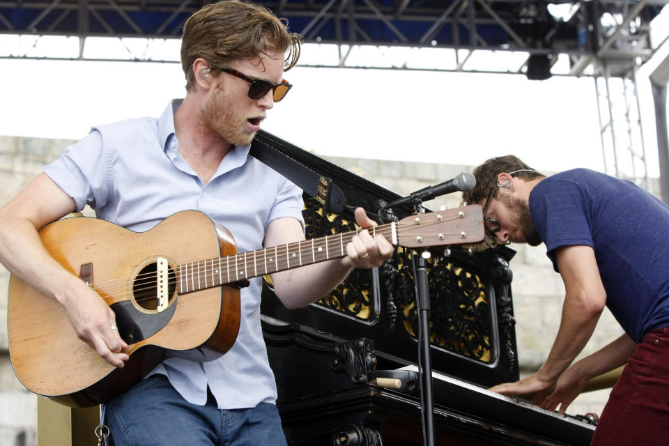 Wesley Schultz, guitar, and Stelth Ulvang of The Lumineers performs at the 54th edition of the Newport Folk Festival in Newport, R.I., on Sunday, July 28, 2013. (AP Photo/Joe Giblin)