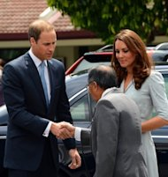 Britain&#39;s Prince William (left) shakes hand with Richard Robless, council member of Hospis Malaysia, upon arrival with his wife Catherine, the Duchess of Cambridge, in Kuala Lumpur on September 13. Britain&#39;s younger royals are touring the globe throughout 2012 as part of celebrations marking the 60-year reign of William&#39;s grandmother, Queen Elizabeth II