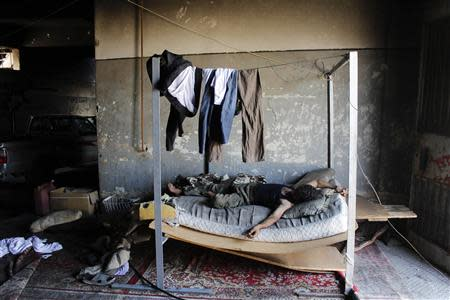 A Free Syrian Army fighter takes a rest in a safe house beside the Canadian Hospital in Aleppo