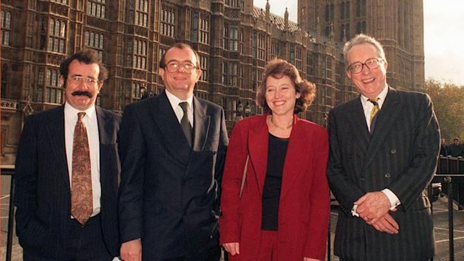 "In this Jan. 22, 2001 file photo, John Sewel, second left, poses with his fellow new Labour peers, from left, Robert Winston, Helene Hayman and Gordon Johnson Borrie, at Westminster, in London. A member of the House of Lords has resigned from the chamber and apologized after he was filmed in an alleged cocaine-and-sex session with prostitutes. John Sewel caved in to pressure on Tuesday, July 28, 2015 telling parliamentary officials in a statement that he was ""terminating my membership of the House of Lords.'' He now says he can best serve the house by leaving it. (Michael Stephens, PA via AP) UNITED KINGDOM OUT"