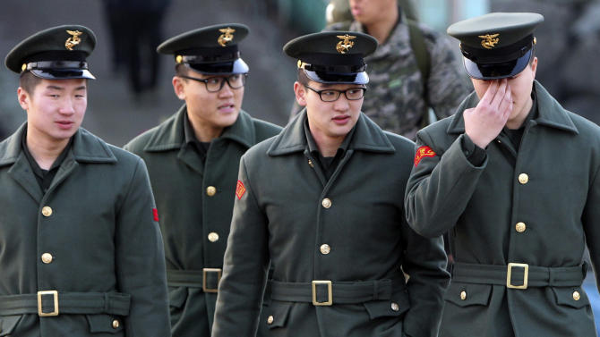 South Korean marines walk to board a ship leaving for Baengnyeong Island at Incheon port in Incheon, west of Seoul, South Korea, Monday, Feb. 20, 2012. South Korea on Monday began live-fire military drills from front-line islands near its disputed sea border with North Korea, despite Pyongyang's threat to attack. (AP Photo/Yonhap, Ha Sa-hun) KOREA OUT