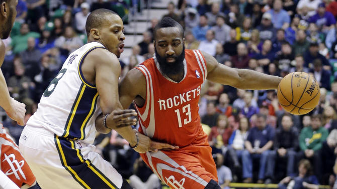 Houston Rockets' James Harden (13) drives around Utah Jazz's Randy Foye (8) during the second quarter of an NBA basketball game, Monday, Jan. 28, 2013, in Salt Lake City. (AP Photo/Rick Bowmer)