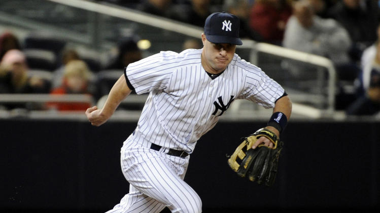 New York Yankees third baseman Jayson Nix chases after a ball he bobbled before throwing out Arizona Diamondbacks' Martin Prado during the third inning of a baseball game, Thursday, April 18, 2013, at Yankee Stadium in New York. (AP Photo/Bill Kostroun)