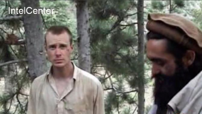 "FILE - This file image provided by IntelCenter on Wednesday Dec. 8, 2010 shows a framegrab from a video released by the Taliban containing footage of a man believed to be Sgt. Bowe Bergdahl, left. A U.S. soldier held by Afghan militants will not be harmed, a senior member of the Pakistan-based Haqqani network told The Associated Press on Saturday, Sept. 8, 2012. However, the United States and NATO can expect stepped up attacks as a result of the Obama administration's decision to declare the network of fighters a terrorist body, he said. He denied an earlier report that the only U.S. prisoner of war, Army Sgt. Bowe Bergdahl would be harmed as a result of the administration's decision.(AP Photo/IntelCenter, File)  MANDATORY CREDIT: INTELCENTER; NO SALES; EDS NOTE: ""INTELCENTER"" AT LEFT TOP CORNER ADDED BY SOURCE"
