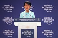 Myanmar democracy icon Aung San Suu Kyi speaks during the 21st World Economic Forum on East Asia in Bangkok. Suu Kyi urged Myanmar&#39;s government to carry out urgent judicial reform to cement recent political progress and foster clean investment in the country