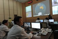 North Korean technicians work at the control room of the Tongchang-ri space centre, on April 8. N.Korea&#39;s long-range rocket is on its launch platform, AFP reporters saw on Sunday, as the regime again insisted it was to send a peaceful satellite and not a missile