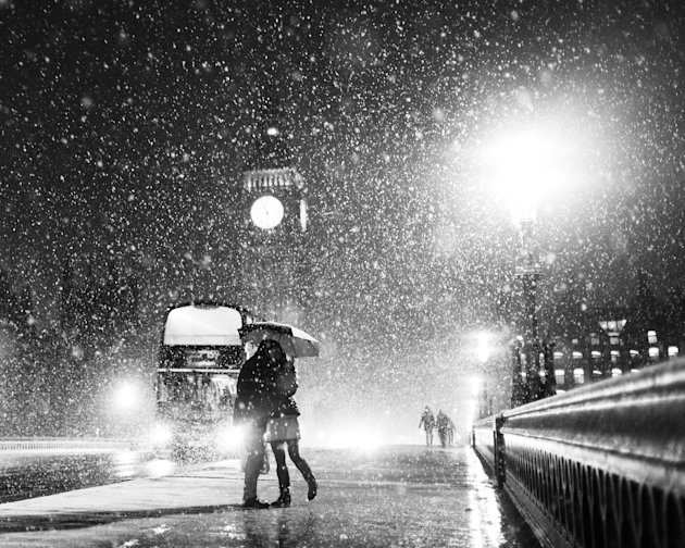 'London when it Snows: Big Ben and Lovers', Westminster Bridge, London: Kayode Okeyode spent around 30 minutes in the snow taking photographs before capturing this image of a couple and a bus in the b