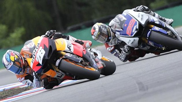 Honda MotoGP rider Dani Pedrosa of Spain (L) rides ahead of Yamaha rider Jorge Lorenzo of Spain during the Czech Grand Prix in Brno (Reuters)