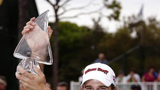 Kevin Streelman holds up his trophy after winning the Tampa Bay Championship golf tournament, Sunday, March 17, 2013, in Palm Harbor, Fla. (AP Photo/Chris O'Meara)