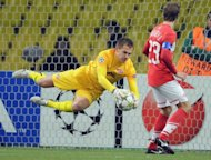 Artem Rebrov (L) of FC Spartak Moscow saves his net playing against SL Benfica during their UEFA Champions League group G football match in Moscow. Russian side Spartak Moscow gained their first win of this season's Champions League campaign after losing their first two matches with a hard fought 2-1 win over Portuguese opponents Benfica here on Tuesday