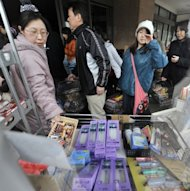 People are seen queuing to buy food and supplies at a supermarket in Kitakami, Iwate prefecture, in 2011. The weak pulse of Japan&#39;s economic recovery has slowed again, with mixed figures showing it is struggling to achieve momentum