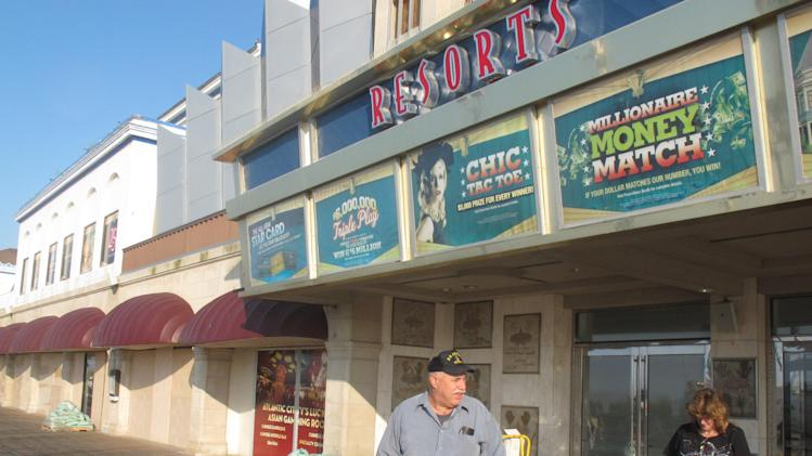 Bill Wischuck of Coatesville, Md. leaves the boarded-up Resorts Casino Hotel in Atlantic City NJ on Friday Aug. 26,2011, as Hurricane Irene approached the gambling resort. Atlantic City's 11 casinos are starting to shut down as Hurricane Irene threatens the nation's second-largest gambling resort. (AP Photo/Wayne Parry)