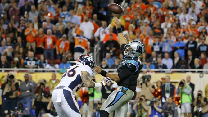 Carolina Panthers' quarterback Newton throws an interception as he is pressured by Denver Broncos' Ray in the third quarter of the NFL's Super Bowl 50 football game in Santa Clara