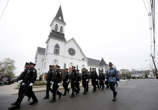Massachusetts Institute of Technology police officers march as they depart St. Patrick's Church in Stoneham, Mass., following a funeral Mass for MIT police officer Sean Collier, Tuesday, April 23, 201
