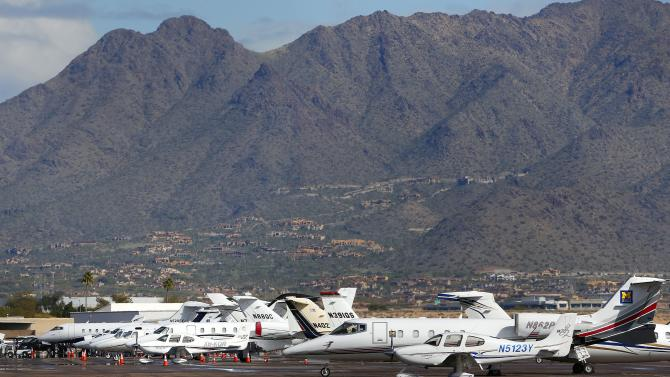 A growing number of private jets sit parked at Scottsdale Airport, Tuesday, Jan. 27, 2015, in Scottsdale, Ariz.  With the NFL Super Bowl football game and the Phoenix Open PGA golf tournament in town, the private jet traffic into the Phoenix-area airports is expected to increase