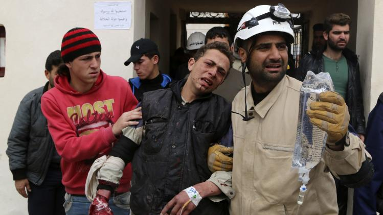 An injured survivor arrives at a hospital with the rescue team in Aleppo