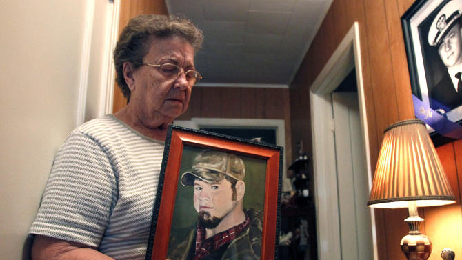 FILE - In this Nov. 13, 2010, file photo, Nelda Winslette, grandmother of Deepwater Horizon oil rig floorhand Adam Weise, holds a painting of Weise in her home in Yorktown, Texas. Weise was one of 11 workers killed after the Deepwater Horizon exploded in the Gulf of Mexico in April 2010. Billions of dollars are on the line when a federal trial opens Monday, Feb. 27, 2012 over the reams of litigation spawned by the nation's worst offshore oil disaster, though those whose losses can't be repaid are hoping for something more elusive: justice for lost loved ones. (AP Photo/Patrick Semansky, File)