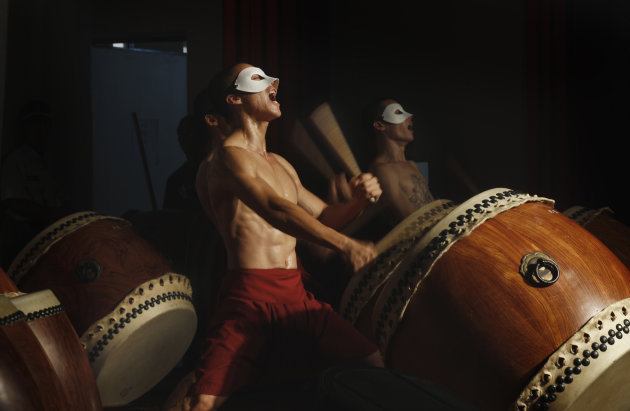 In this June 16, 2011, photo, young convicts perform rhythmical drum beats to a prison audience in Chiayi, central Taiwan. Taiwan's U-Theatre Ensemble of drummers and Chinese operatic dancers leverage the spirituality of Zen Buddhism and Tai Chi Chuan exercises to try to instill a new sense of equanimity among the young convicts, most of whom have violence tinged-records mixed with serious drug abuse. (AP Photo/Wally Santana)