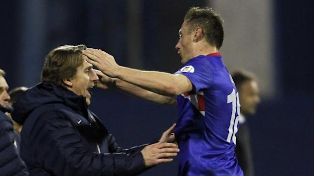 Croatia's Ivica Olic (R) celebrates with Alen Boksic after scoring against Serbia during their 2014 World Cup qualifying match at Maksimir stadium in Zagreb (Reuters)