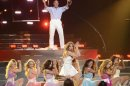 Pitbull and Jennifer Lopez perform during the Season 12 finale of