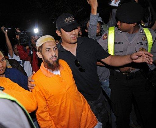 Umar Patek (wearing orange shirt) was one of Asia's most wanted terror suspects and had a $1 million bounty
