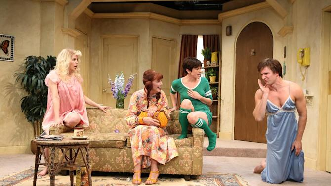 """FILE - This undated publicity file photo released by Kornberg PR shows, from left, Anna Chlumsky, Kate Buddeke, Hannah Cabell and Jake Silbermann in a scene from David Adjmi's play, """"3C,"""" performing off-Broadway at Rattlestick Playwrights Theater in New York. A group of theater community heavyweights, including Jon Robin Baitz, Stephen Sondheim, Tony Kushner, John Guare and Terrence McNally, have signed an open letter defending the playwright, Adjmi, whose play parodying 1970's sitcoms has been accused of copyright infringement by lawyers representing the TV show """"Three's Company."""" (AP Photo/Kornberg PR, Joan Marcus, File)"""