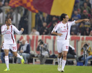 AC Milan's Alessandro Nesta, right, celebrates with teammate Robinho, of Brazil, after scoring during a Serie A soccer match against AS Roma, in Rome, Saturday, Oct. 29, 2011. (AP Photo/Alfredo Falcone, LaPresse) ITALY OUT