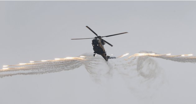 A Surion helicopter of the South Korean Army fires flares during a photo call for the media at the Army Aviation School in Nonsan, about 190 km (118 miles) south of Seoul
