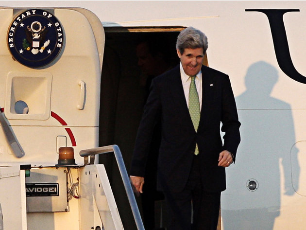 U.S. Secretary of State John Kerry disembarks at Ciampino military airport, in the outskirts of Rome, Wednesday, Feb. 27, 2013. Kerry will attend an international conference on Syria in Rome Thursday.