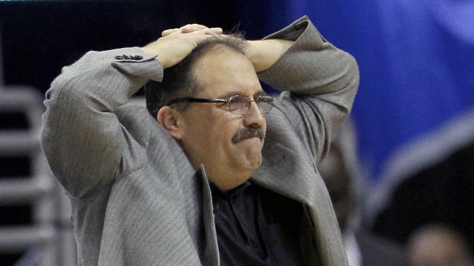 FILE - This May 5, 2012 file photo shows Orlando Magic head coach Stan Van Gundy watching his team during the first half of Game 4 of an NBA first-round playoff basketball series against the Indiana Pacers, in Orlando, Fla. The Magic have fired coach Van Gundy after a rocky season. The moves came Monday, May 21, 2012 after the team's second straight first-round playoff exit. (AP Photo/John Raoux, File)