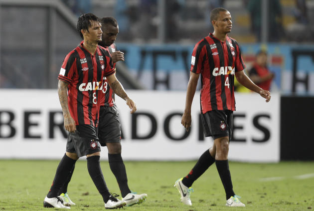 Brazil's Atletico Paranaense players leave the pitch at the end of their Copa Libertadores soccer match against Peru's Sporting Cristal in Lima, Peru, Wednesday, Jan. 29, 2014. Peru's Spor