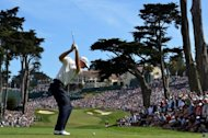 Jim Furyk of the US hits his tee shot on the eighth hole during the third round of the 112th US Open at The Olympic Club on June 16. Former winners Furyk and Graeme McDowell will take a one stroke joint lead into the final round at the US Open