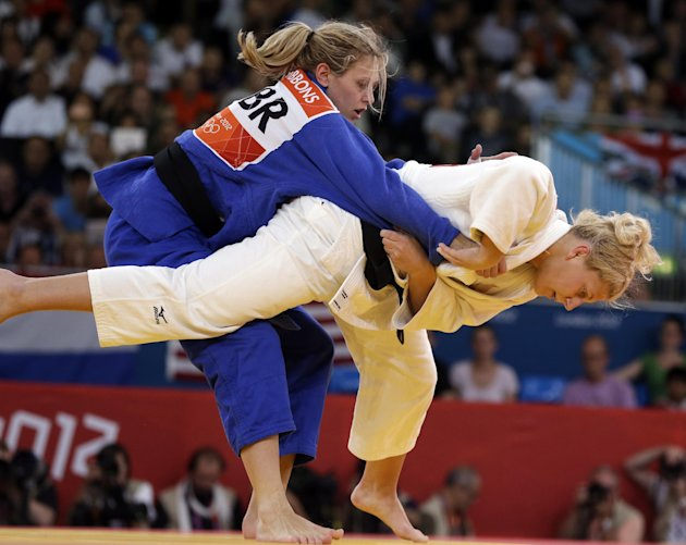 Kayla Harrison of the United States (in white) competes against Gemma Gibbons of Great Britain for the gold medal during the women's 78-kg judo competition at the 2012 Summer Olympics, Thursday, A