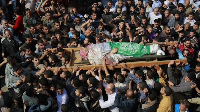 Palestinian mourners carry the body of Hamas' top military commander Ahmed Jabari, killed in an Israeli strike on Wednesday, during his funeral in Gaza City, Thursday, Nov. 15, 2012. (AP Photo/Adel Hana)