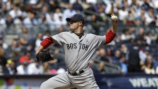 Boston Red Sox starting pitcher Jon Lester (31) delivers in the first inning against the New York Yankees at an Opening Day baseball game at Yankee Stadium in New York, Monday, April 1, 2013.  (AP Photo/Kathy Willens)