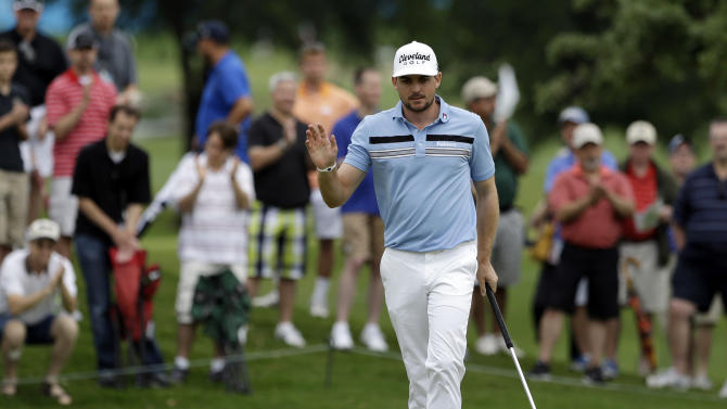 Keegan Bradley acknowledges applause from the gallery after sinking a putt for birdie on the second green during the first round of the Byron Nelson Championship golf tournament Thursday, May 16, 2013, in Irving, Texas. Bradley set the TPC Four Seasons course record with a 10-under par 60 in the opening round. (AP Photo/Tony Gutierrez)