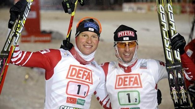 Bernhard Gruber (L) and Mario Stecher of team Austria I celebrate winning the Nordic Combined Team Sprint 2x7.5 km competition of the FIS World Cup Ruka Nordic Opening 2012 in Kuusamo (Reuters)