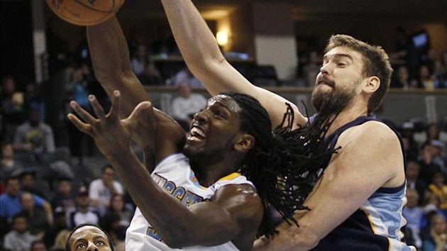 Memphis Grizzlies center Marc Gasol (R) fights for a rebound with Denver Nuggets forward Kenneth Faried in the third quarter of their NBA basketball game in Denver (Reuters)