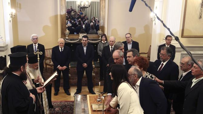 Newly appointed ministers and deputy ministers attend a swearing in ceremony at the presidential palace in Athens