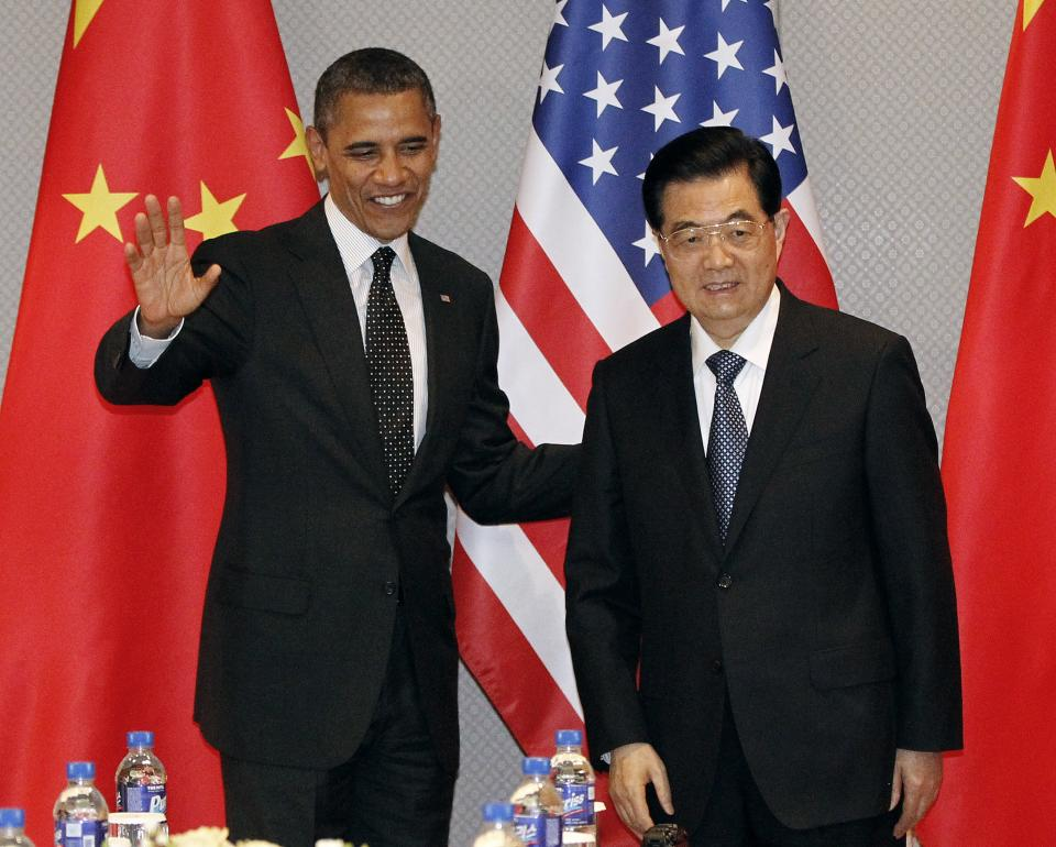 President Barack Obama, left, greets Chinese President Hu Jintao at the start of their bilateral meeting in Seoul, South Korea, Monday, March 26, 2012. (AP Photo/Pablo Martinez Monsivais)