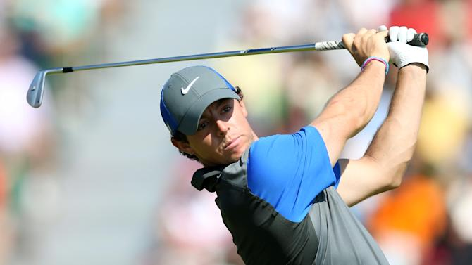 Rory McIlroy of Northern Ireland plays a shot off the 4th tee during the first day of the British Open Golf championship at the Royal Liverpool golf club, Hoylake, England, Thursday July 17, 2014. (AP Photo/Scott Heppell)