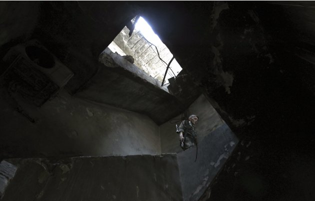 A member of the Free Syrian Army is seen inside a building in the old city of Aleppo