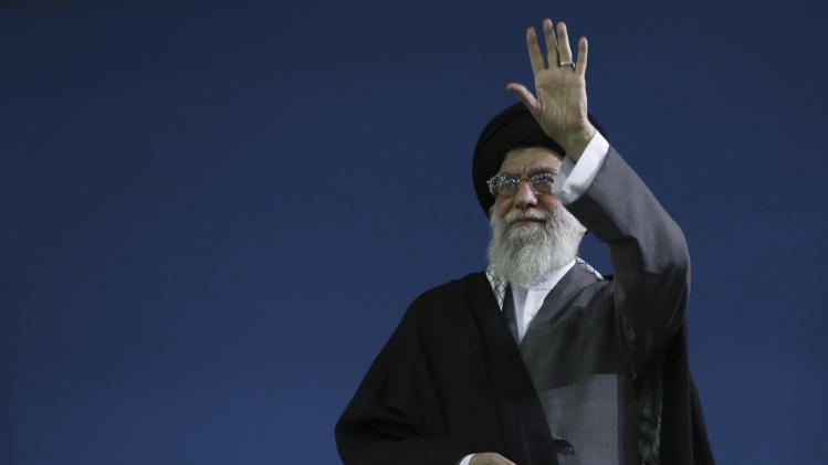 In this photo released by an official website of the Iranian supreme leader's office, Supreme Leader Ayatollah Ali Khamenei, waves to the crowd at the conclusion of his speech in Tehran, Iran, Saturday, Feb. 16, 2013. Iran's Supreme Leader said Saturday that his country is not seeking nuclear weapons, but that no world power could stop Tehran's access to an atomic bomb if it intended to build one. (AP Photo/Office of the Supreme Leader)