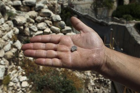 A clay seal recently unearthed by Israeli archaeologists is displayed just outside Jerusalem's Old City