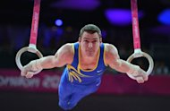 Brazil's gymnast Arthur Nabarrete Zanetti performs to win gold in the men's rings final of the artistic gymnastics event of the London Olympic Games at the 02 North Greenwich Arena in London