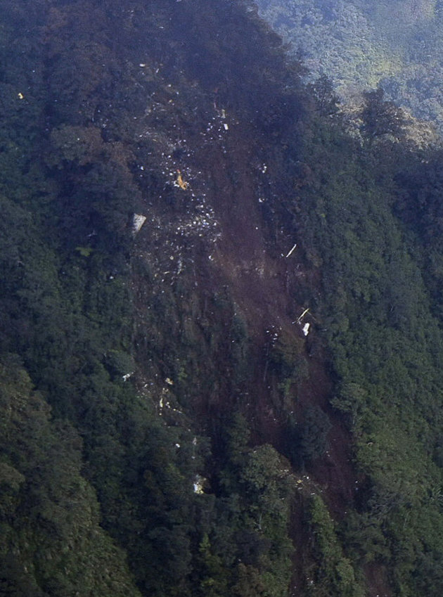 In this picture released by Indonesian Air Force,  the wreckage of a missing Sukhoi Superjet-100 are scattered on the mountainside in Bogor, West Java, Indonesia, Thursday, May 10, 2012. The new Russi