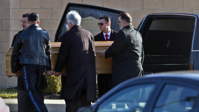 FILE - In this Dec. 18, 2013 file photo, the casket of Dustin Friedland is carried into a temple for a funeral service in Lakewood, N.J. Four men charged in the fatal carjacking of the young lawyer at an upscale New Jersey mall just before Christmas were due in court Wednesday, Jan. 8, 2014, for arraignment. (AP Photo/The Asbury Park Press, Doug Hood) NO SALES